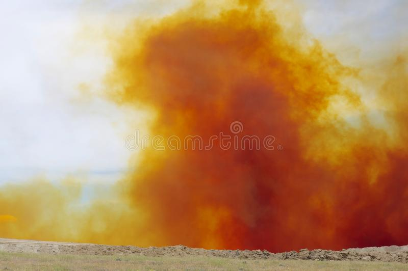 Nitrogen Dioxide cloud after mine blast. Dust cloud from a open pit mine blast. The color is caused by nitrogen dioxide stock images