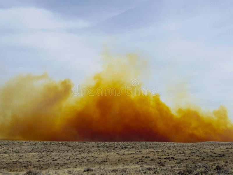 Nitrogen dioxide dust cloud from a mine blast. Dust cloud from a open pit mine blast. The color is caused by nitrogen dioxide royalty free stock photography
