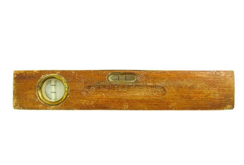 Niveau d'eau en bois de vieux vintage d'isolement sur le blanc photo libre de droits