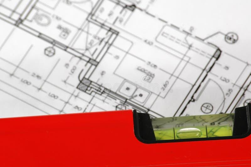 Niveau d'eau et plans architecturaux images libres de droits