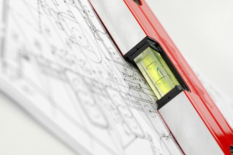Niveau d'eau et plans architecturaux photos libres de droits