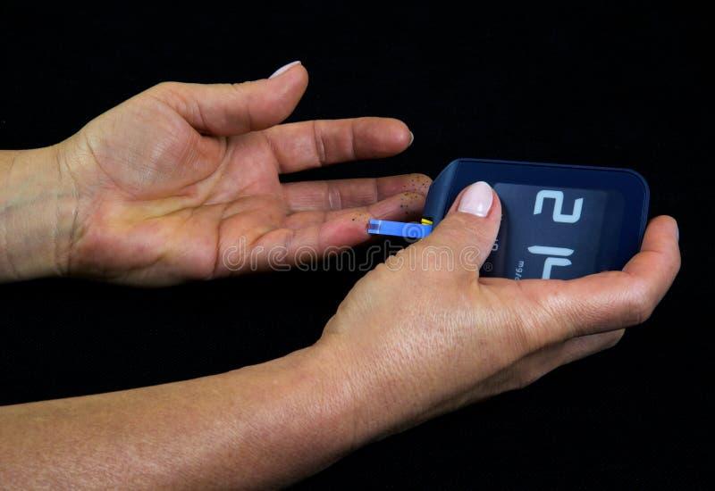 Niveau de mesure de glucose dans le sang image libre de droits