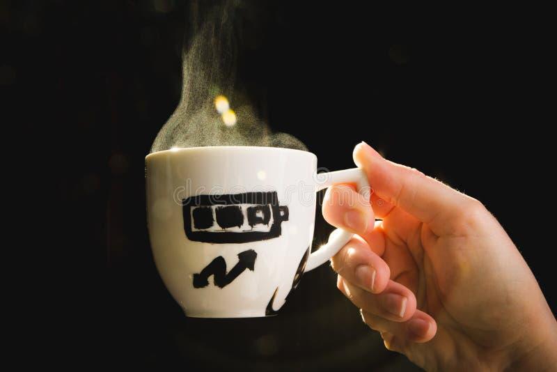 Nivel de energía de medición de la taza de café en español fotos de archivo libres de regalías