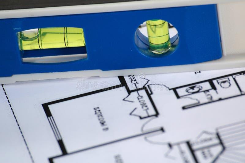 Nivel del agua y planes arquitectónicos imagen de archivo