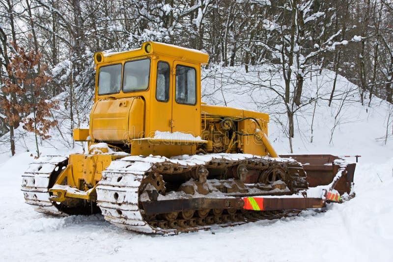 Niveladora en el invierno imagen de archivo libre de regalías