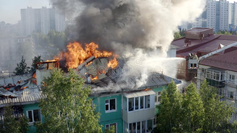 Nizhnevartovsk, Russia - July 1, 2019: firefighters extinguish a fire on the roof of a residential high-rise building stock image