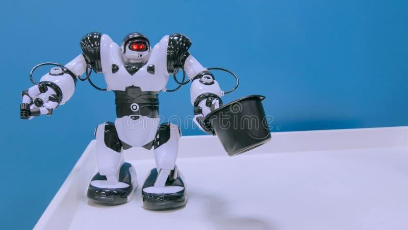 White humanoid robot dancing stock photography