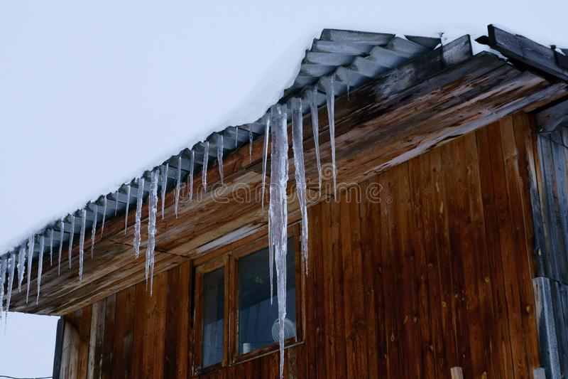Russia, in Nizhny Novgorod, the first thaw, on the roofs of houses icicles. In Nizhny Novgorod came the first thaw on the roofs of houses appeared icicles stock photo