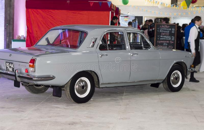 Solemn opening of the salon for the sale of automobiles, Firm `Nizhegorodets.` The car Volga GAZ 24 light gray. stock photos