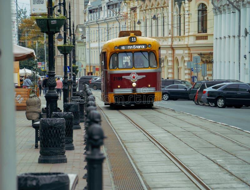 NIZHNY NOVGOROD, RUSSIA - AUGUST 09, 2019: old tram goes along Rozhdestvenskaya street. royalty free stock photos