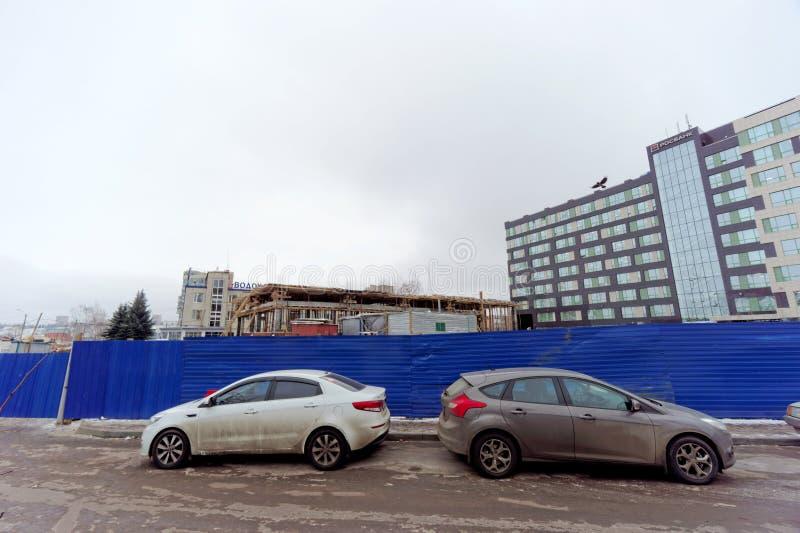 Nizhny Novgorod, Russia. - December 1.2017. Construction of the Strelka metro station behind the blue fence. stock photos