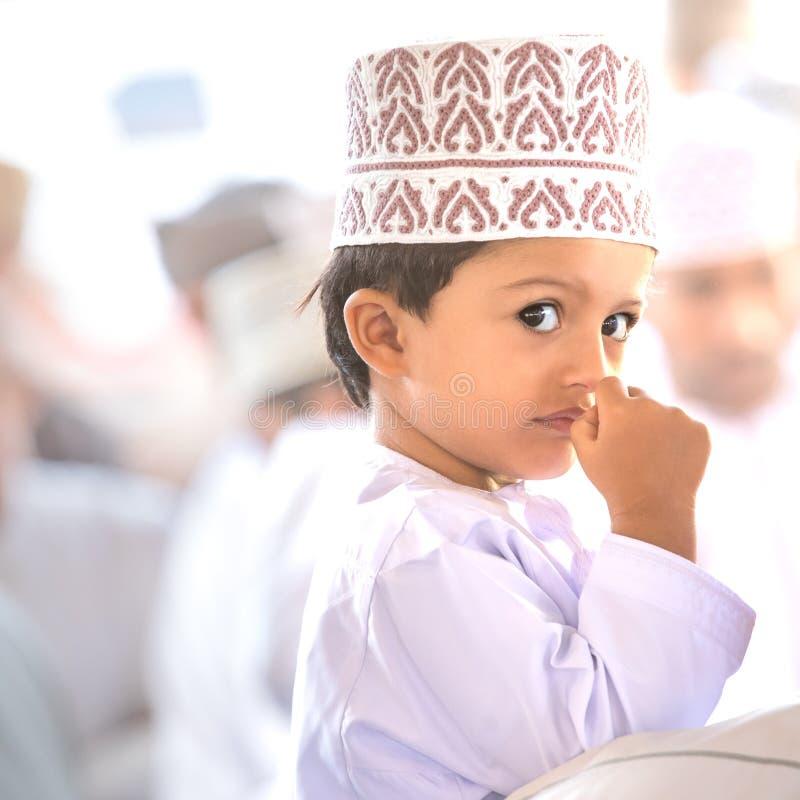 Little shy Omani boy poking his nose. royalty free stock photos