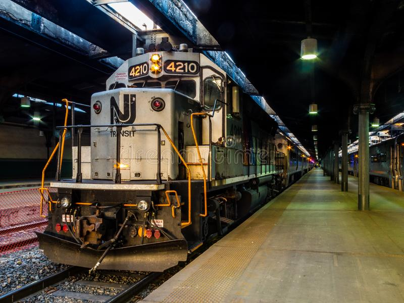 NJT Commuter Train ready for the rush hour ride home. Hoboken, NJ/Unites States-June 21, 2016: A view of a New Jersey Transit locomotive waiting to depart from royalty free stock photos