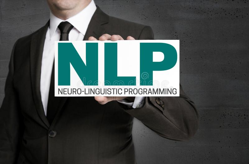 Nlp标志由商人举行 免版税图库摄影
