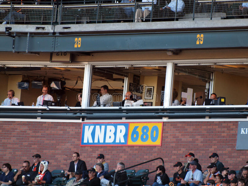 Announcer Jon Miller sits in the KNBR booth. Giants Vs. Marlins: Hall of fame announcer Jon Miller sits in the KNBR 680 broadcast booth as he calls the game from stock image