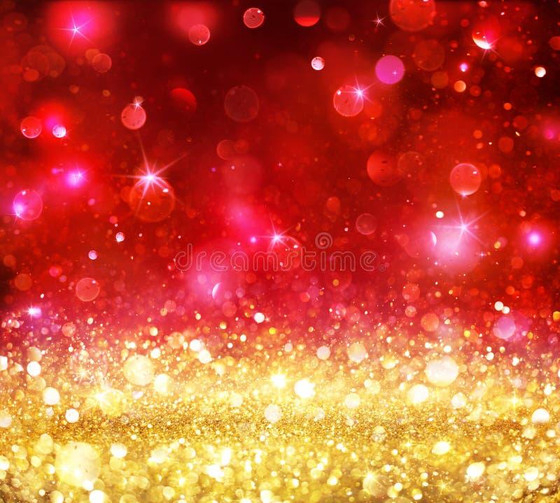 Noël Bokeh - scintillement d'or avec le rouge brillant image libre de droits