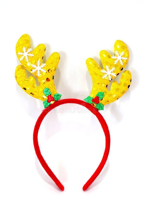 Noël de bandeau, andouillers de renne jaunissent la poupée rouge bandeau-ha photo libre de droits