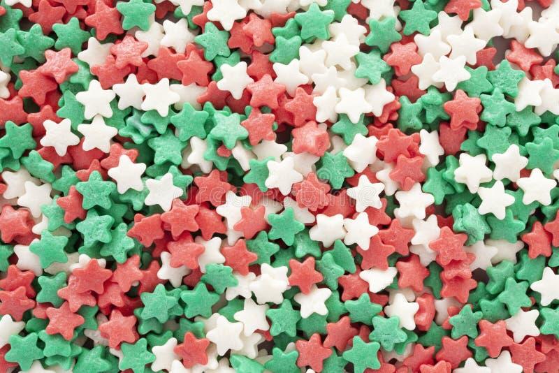 Noël en forme d'étoile arrose le fond photo stock