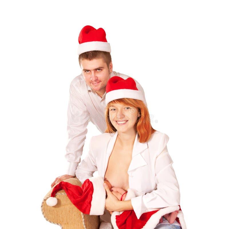 Noël fait maison. Famille heureuse en père noël photographie stock libre de droits