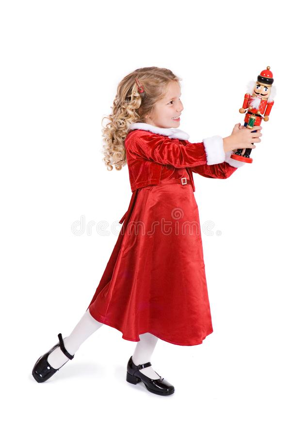 Noël : La fille mignonne fait la pose de ballet avec le casse-noix photo libre de droits