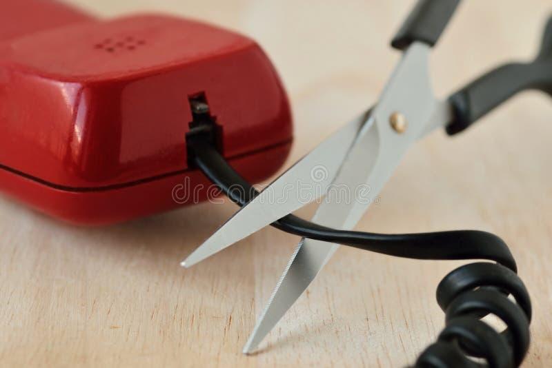 Nożyce ciie telefonicznego sznur - pojęcie kabla naziemnego telefon obrazy royalty free