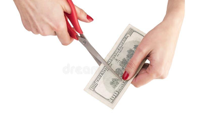 Nożyce są rżniętym dolarem zdjęcie stock