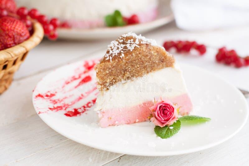 No bake strawberry cheesecake slice. Delicate no bake strawberry cheesecake slice on white plate decorated rosebud stock photos