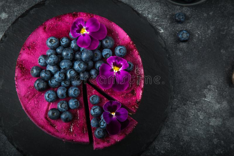 no baked blueberry mousse cake on dark background, selective focus, royalty free stock photos