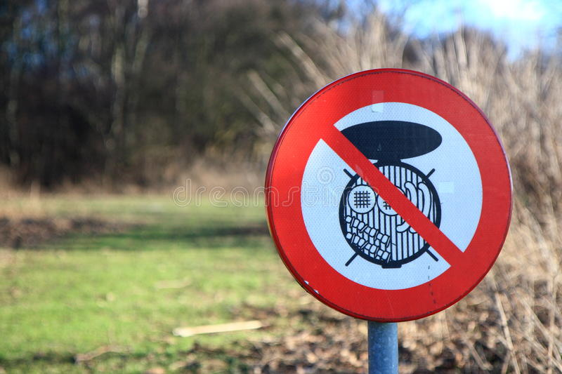 No barbecue sign. In a park with grass field and bushes royalty free stock images