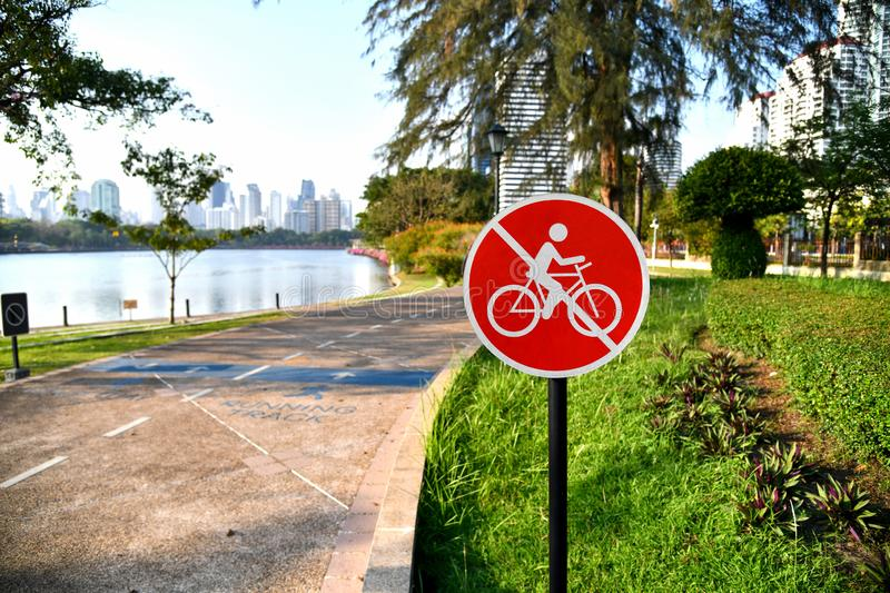No bikes allowed sign beside running track at the park in Bangkok, Thailand. royalty free stock photos