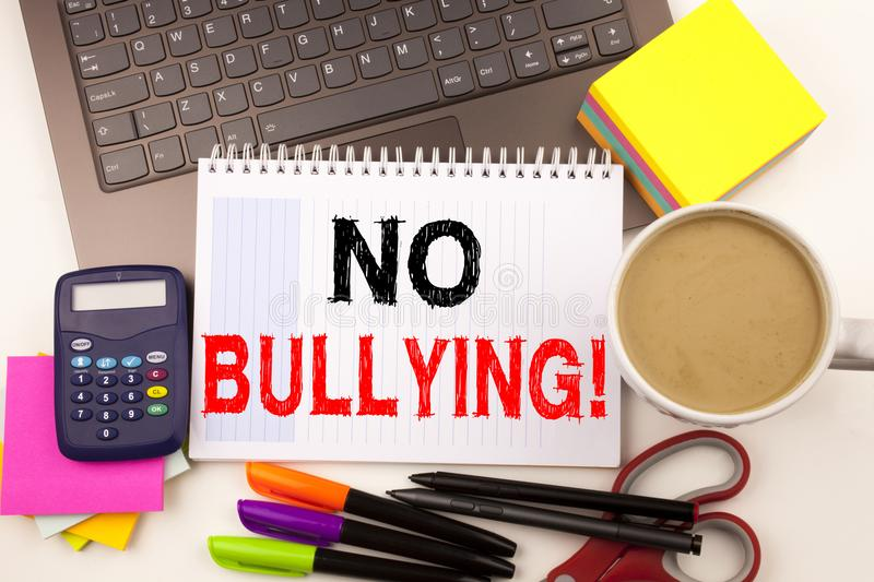 No Bullying text in the office with surroundings such as laptop, marker, pen, stationery, coffee. Business concept for Bullies Pre. Vention Against School Work royalty free stock images