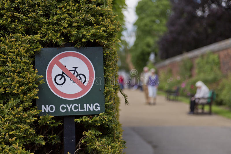 No Cycling Sign. A NO Cycling sign in park in Southern England stock images