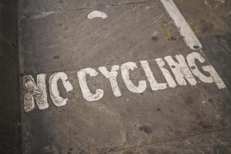 No cycling written on asphalt of pedestrian pathway tunnel stock image