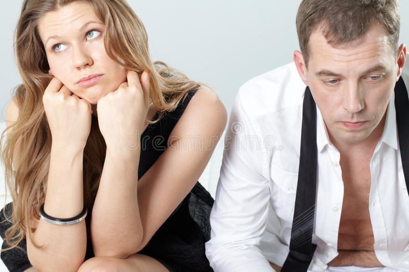 No desire. Two valentines sitting together displeased and looking away stock images