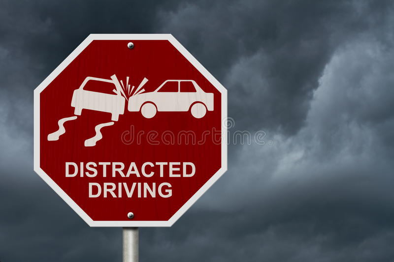 No Distracted Driving Sign. Red stop sign with words Distracted Driving and accident icon with stormy sky background royalty free stock photography