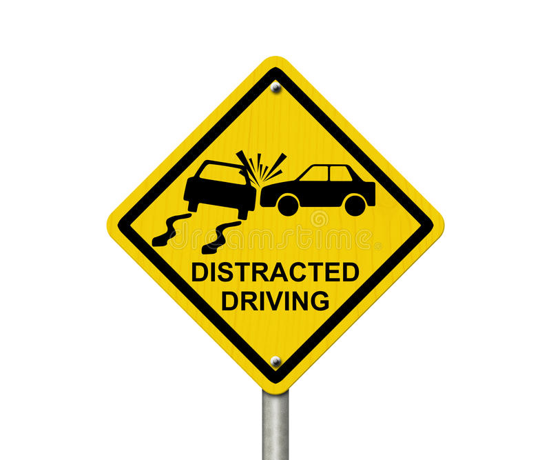 No Distracted Driving Sign. Yellow warning sign with words Distracted Driving and accident icon isolated on white stock photos