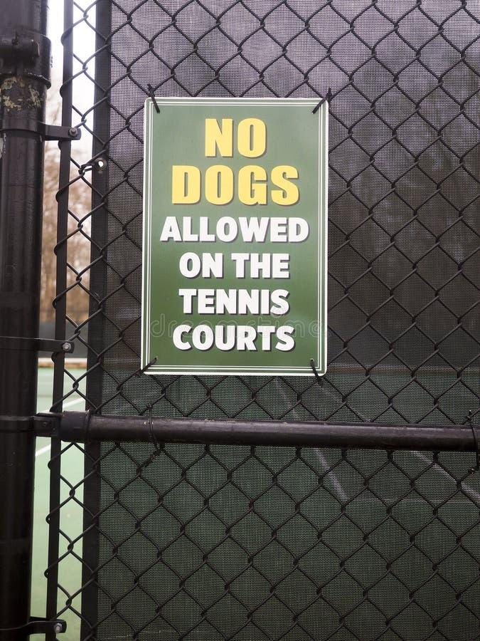 NO DOGS sign tennis court stock photos