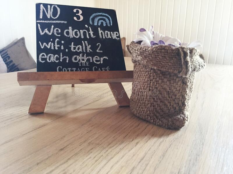 No 3 We Dont Have Wifi Talk 2 Each Other Text on Black Board stock photo