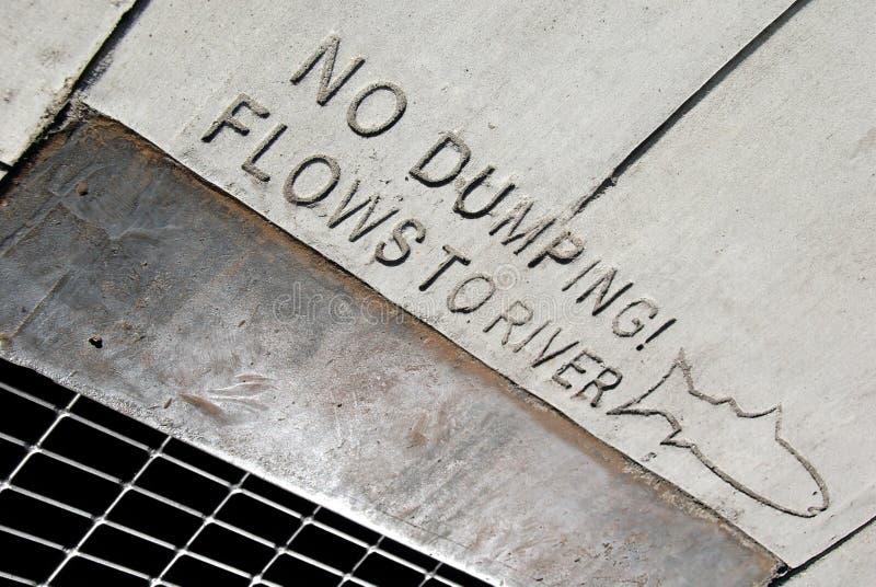 No Dumping. Environmental awareness notice on public drainage stock photo