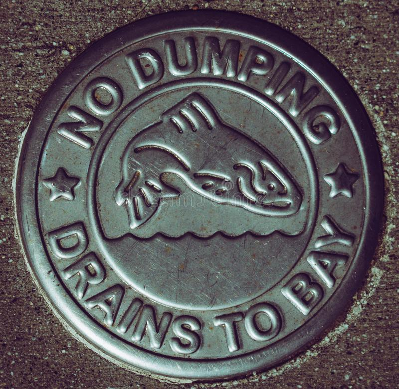 No Dumping Drains to Bay stock photography