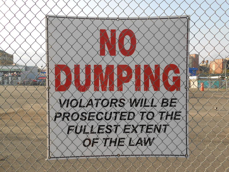 No Dumping Sign on Coney Island. No Dumping - Violators Will Be Prosecuted to the Fullest Extent of the Law sign on Coney Island Beach, New York stock photography