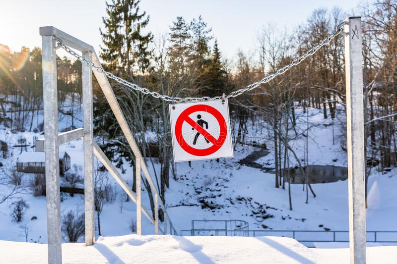 """No entry"", ""Do not enter"" Sign in a Park in Metal Chains on a Sunny Winter Day. Concept of Restricted Area stock photo"