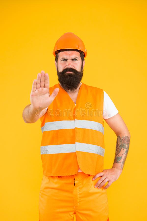 No entry. Man engineer protective uniform stop you. Architect builder engineer. Protective apparel for construction royalty free stock photos
