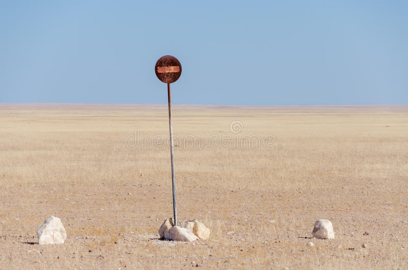 No entry or passage prohibited sign in the middle of the Namib Desert isolated in front of blue sky. And desert vista royalty free stock photo