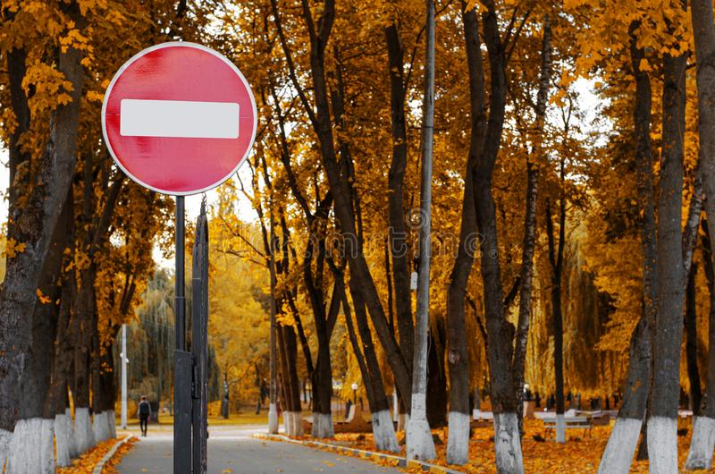 No entry road sign in autumn park. stock photos