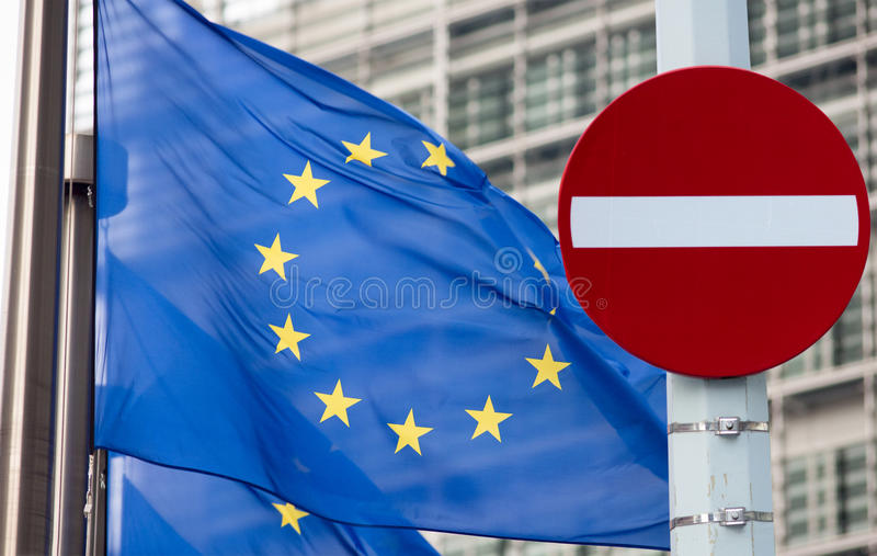 No entry sign in front of EU flag. Sanctions concept. No entry sign in front of EU flag royalty free stock photography