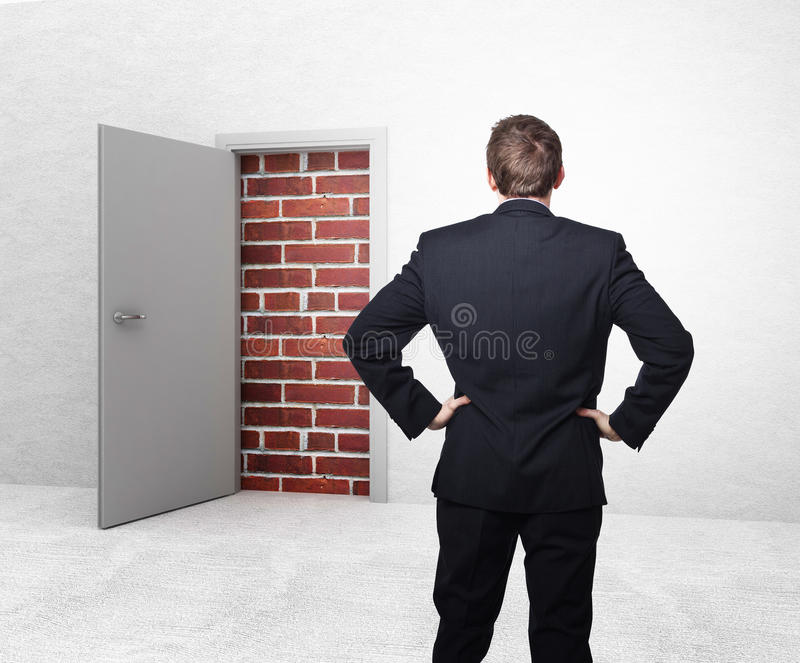 No escape. White open door and brick wall 3d royalty free stock image