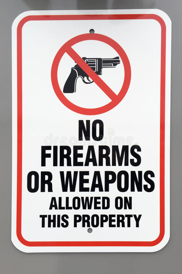 No firearms or weapons warning sign. Stands at the entrance to many buildings and public areas royalty free stock photos