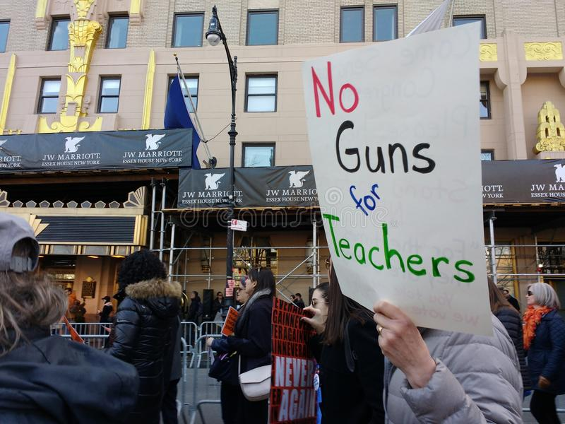 No Guns for Teachers, March for Our Lives, Protest, NYC, NY, USA. A demonstrator carries a sign saying, `No Guns for Teachers` during the New York City March for stock images