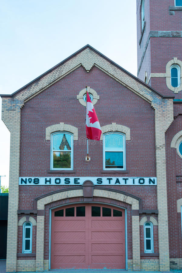 No 8 Hose Fire Station, historical bulding in Little Italy, Toronto. The facade with the national flag of Canada on the wall of the No. 8 Hose Station. Small stock images